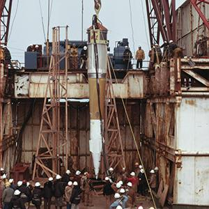 "1971: The nuclear warhead used in the ""Cannikin"" test on the Aleutian Island of Amchitka is lowered into the shaft. Photo: © Lawrence Livermore National Laboratory"