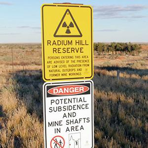 While uranium mining was halted at Radium Hill in 1961 and no more radioactive waste has been deposited there since 1998, the entire site remains a radioactive danger zone, with tailings and waste rock not properly secured from erosion and dispersion.