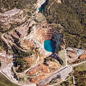 Midnite Mine, the only open-pit uranium mine in the northwestern United States, produced fissile material for the U.S. nuclear weapons program. A clean-up plan was not drafted until 30 years after the mine was decommissioned.